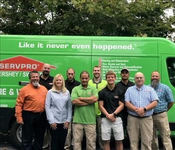 SERVPRO of Lebanon County team photo smiling in front of a green SERVPRO Promaster van