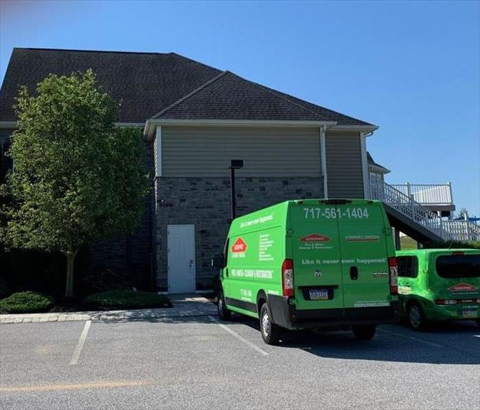 SERVPRO vehicles parked at TOA clubhouse water loss job