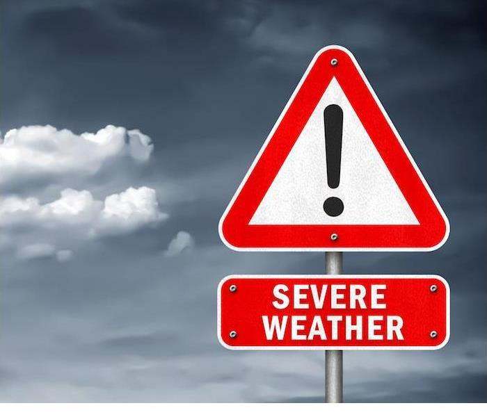 severe weather red sign with dark cloudy sky in background